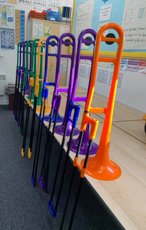 Pbones of different colours stacked in a classroom