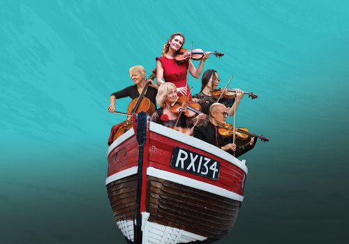 London Mozart Players by the coast in a boat