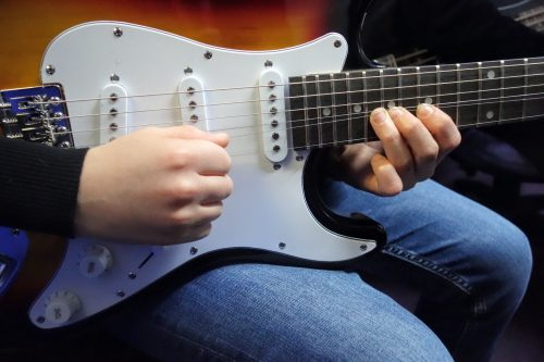 Close-up of electric guitar being played